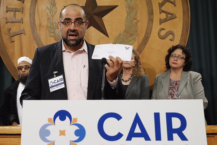 Ahmed Mahmoud of the Austin chapter of the Council on American-Islamic Relations holds up a letter sent by state Rep. Kyle B…