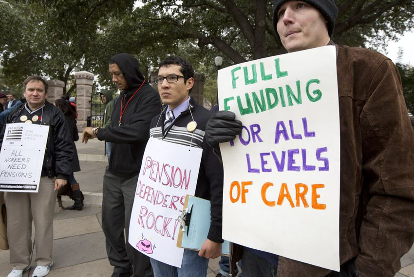 State employees with the Texas State Employees Union (TSEU) hold a small rally at the Texas Capitol entrance during the first day of the session on Jan. 13, 2015.