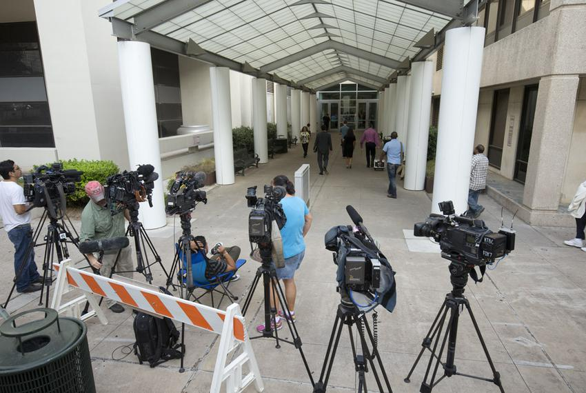 News crews anticipated that Gov. Rick Perry would be processed on Monday, Aug. 18, 2014, at Travis County's Blackwell-Thurma…