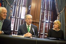 Gov. Greg Abbott speaks at a press conference on Harvey recovery efforts at the state Capitol on Nov. 17, 2017. Abbott is flanked by Sen. John Cornyn and Pam Patenaude, deputy secretary for the U.S. Department of Housing and Urban Development.