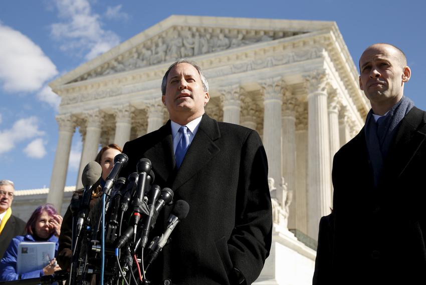 Texas Attorney General Ken Paxton addresses reporters on the steps of the U.S. Supreme Court after the court took up a major…