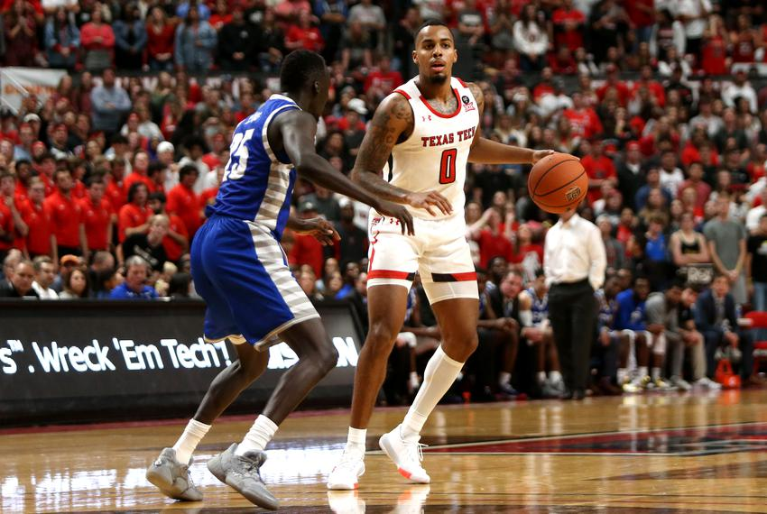 Texas Tech Red Raiders guard Kyler Edwards controls the ball against Eastern Illinois Panthers guard Deang Deang at United...