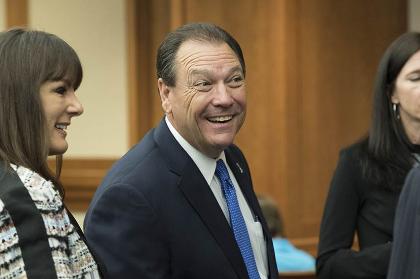 """Henry """"Hank"""" Whitman, new head of the Dept. of Family and Protective Services, greets visitors to the House Committee on Human Services July 12, 2016 prior to his testimony on his vision for reform at the agency."""