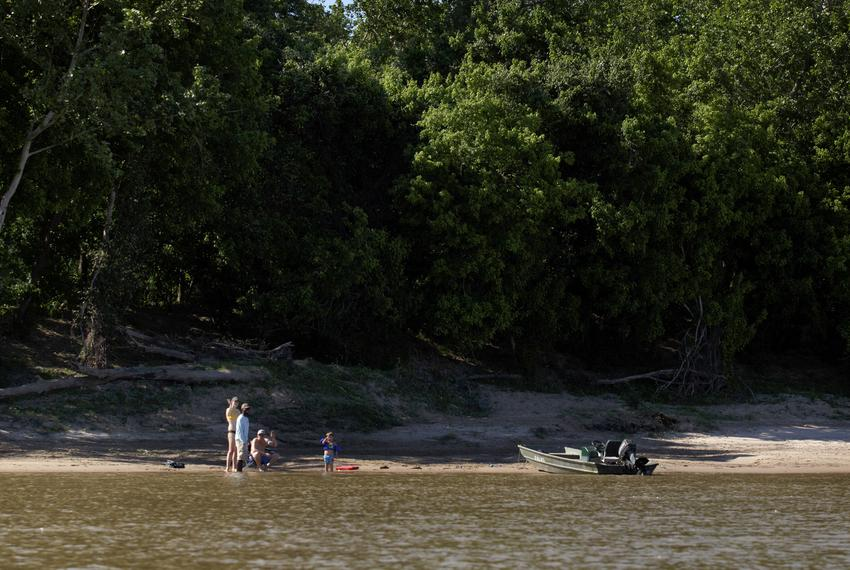 A family enjoys the water on a sand bar along the Colorado River, across from Skull Creek on April 14, 2019.