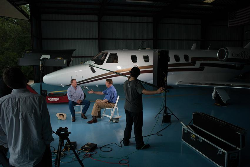 Texas A&M University System Regent Jim Schwertner and former Regent Richard Box participate in an interview for a new movi...