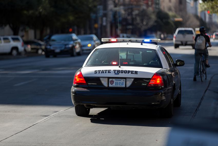 State Troopers stop civilian on Congress Ave. in Austin, TX on Feb. 12, 2016.