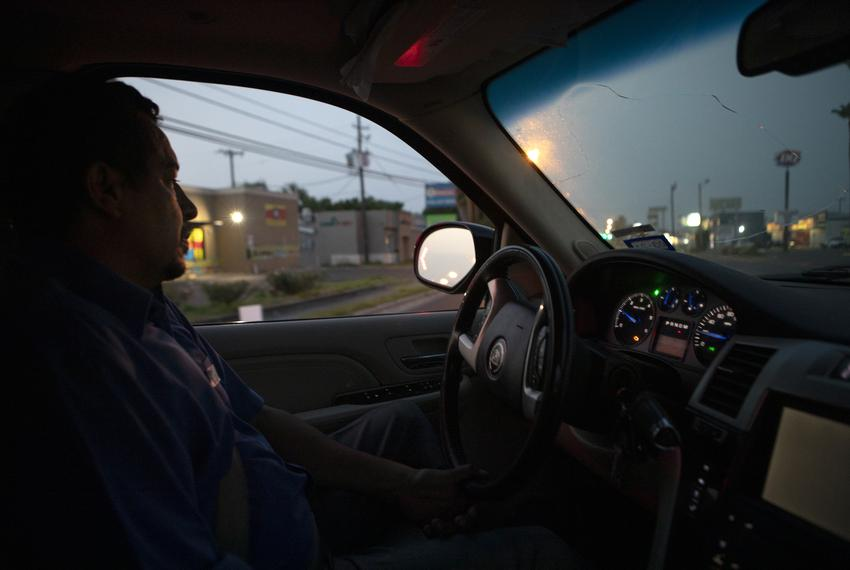 Juan Lopez works in the early morning of the day to pick-up and transport bodies from hospital morgues to funeral homes. SIn…