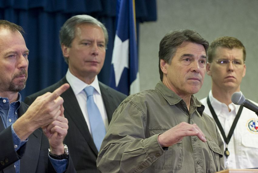 Gov. Rick Perry, r, answers a question on the West, TX disaster at DPS headquarters on April 18, 2013.