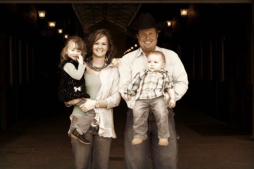 Ashley and Cody Murray, ranchers in Palo Pinto County, pose with their two children. They allege nearby gas drilling caused methane to leak into their water well before it exploded, severely burning the couple, their four-year-old daughter and Cody's father. Their legal case could put pressure on Texas regulators.