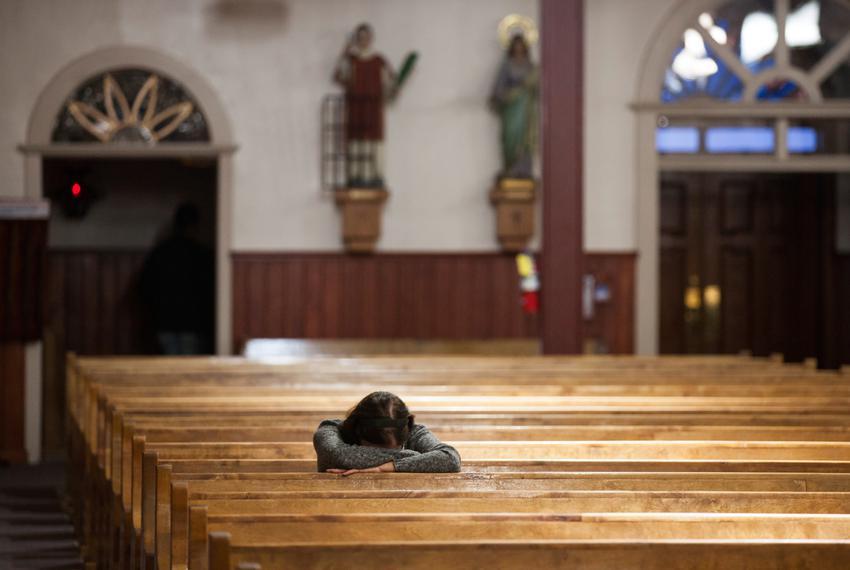 A parishioner prays in a church in Texas.