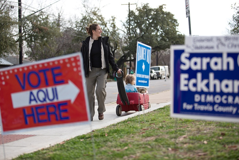 Campaign signs outside a polling place at Zilker Elementary School in Austin on March 4, 2014.