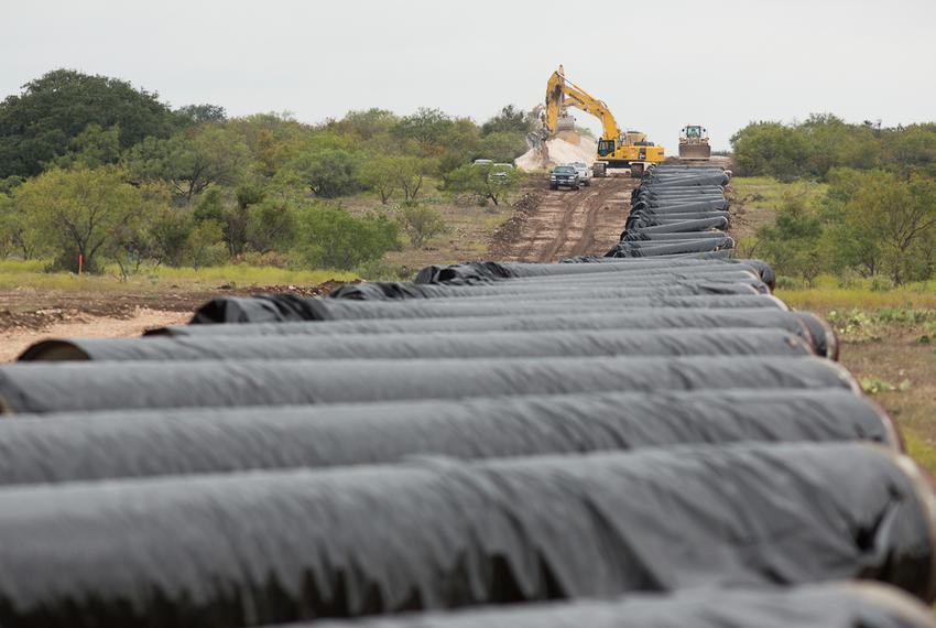 Covered water main awaiting placement along a 60-mile-long pipeline running near Eden, Texas.