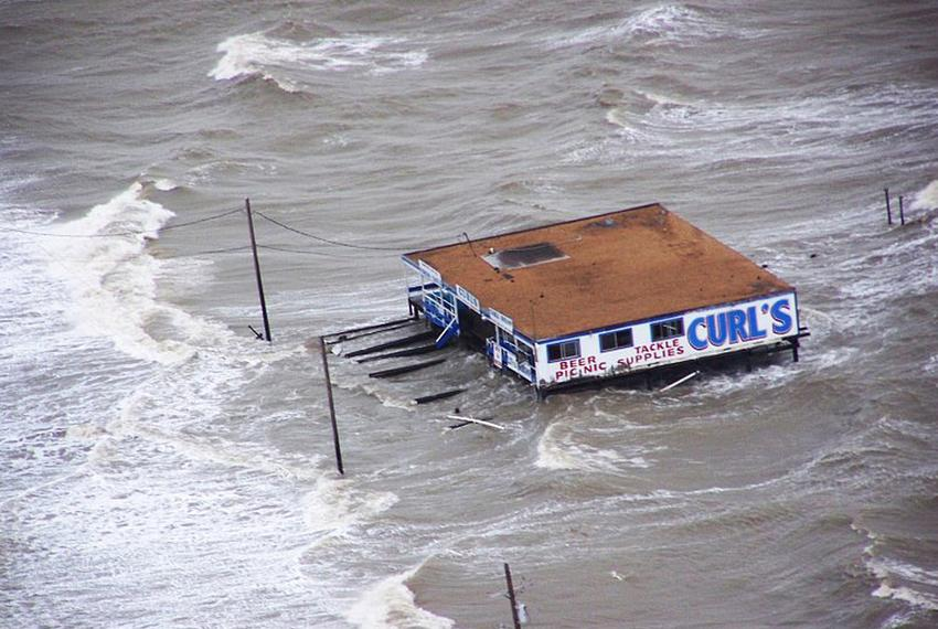 Joint Task Force-129 crew, Jolly 92, flies over the storm surge that overtook the Bolivar Peninsula bridge near Galveston, T…
