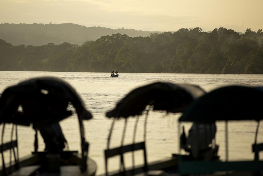 A boat passes on the Usumacinta River on Nov. 17, 2019.