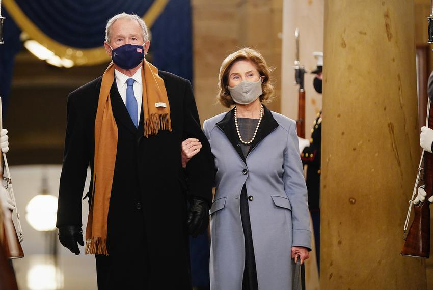 Former U.S. President George W. Bush and Laura Bush arrive in the Crypt of the U.S. Capitol for the 59th Presidential Inaugu…