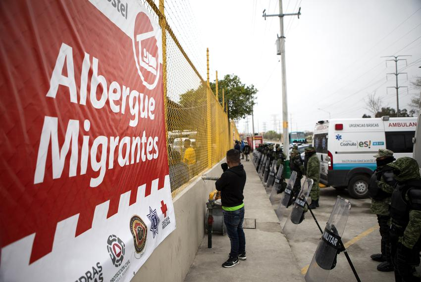 Mexican police and military line the exterior of the shelter currently holding an estimated 1700 migrants. According to the …