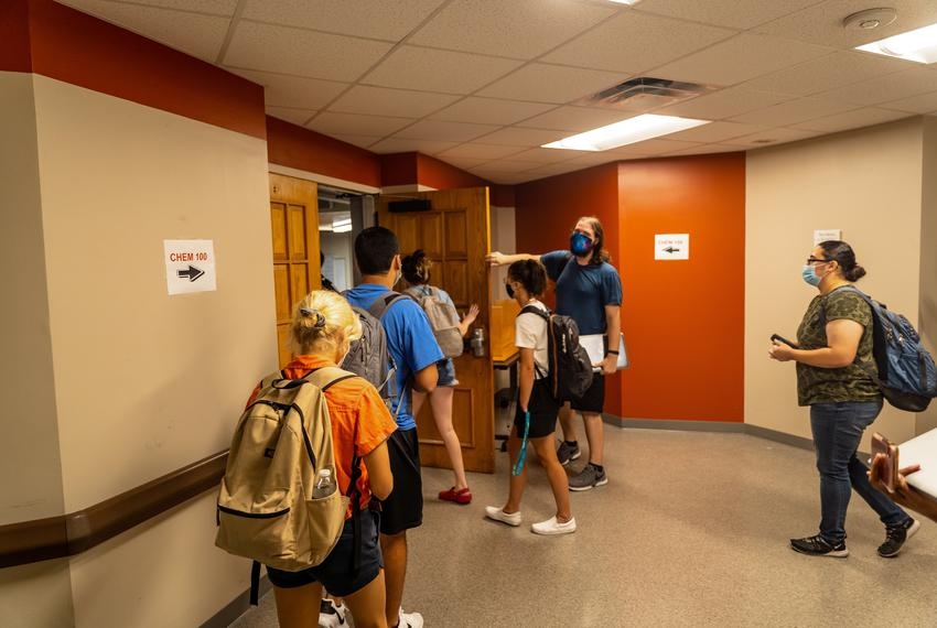 Students enter room 100 in the chemistry building for the first day of Physical Chemistry on the Texas State University camp…