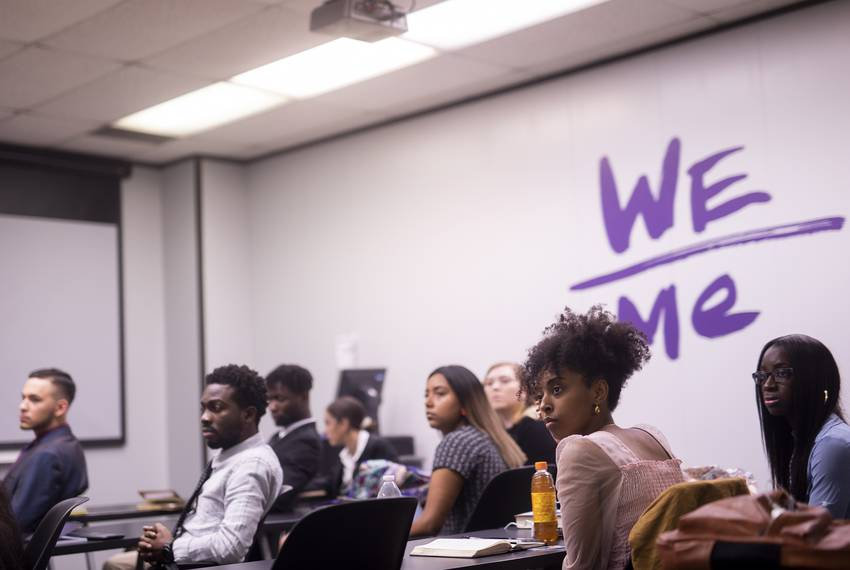 Paul Quinn College student Aden Jemaneh and the rest of the class listen to President Sorrell during his class on problem solving on Nov. 10, 2019.