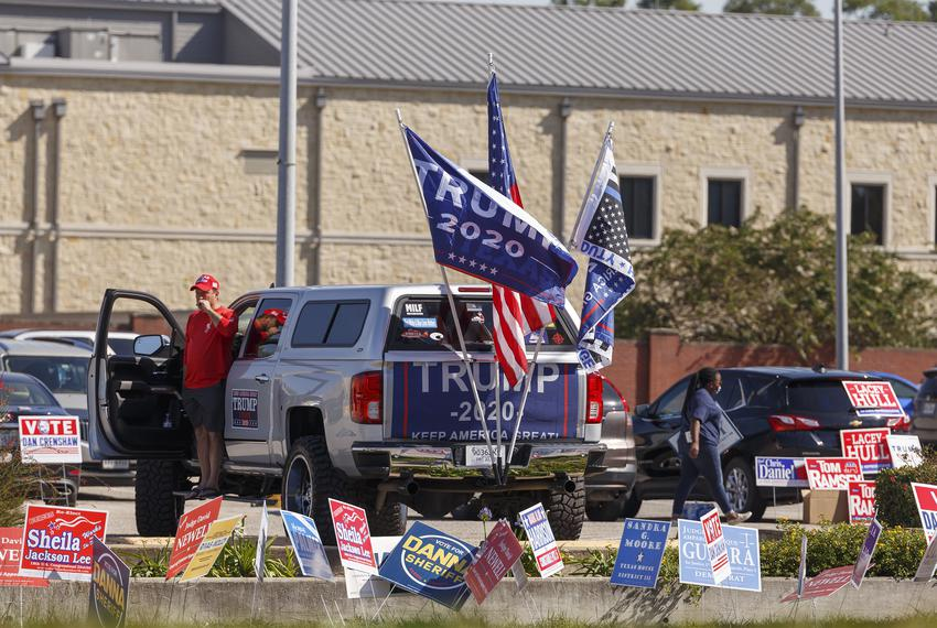 A Trump supporter with his truck at Harris County Trini Mendenhall Community Center in Houston,Tuesday, November 3, 2020 as …