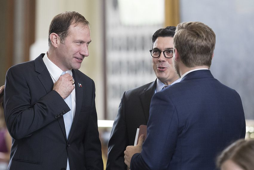 Sen. Charles Schwertner, R-Georgetown, visits with State Rep. Chris Paddie, R-Marshall, after Senate passage of HB 100, which would regulate ride-hailing companies statewide.