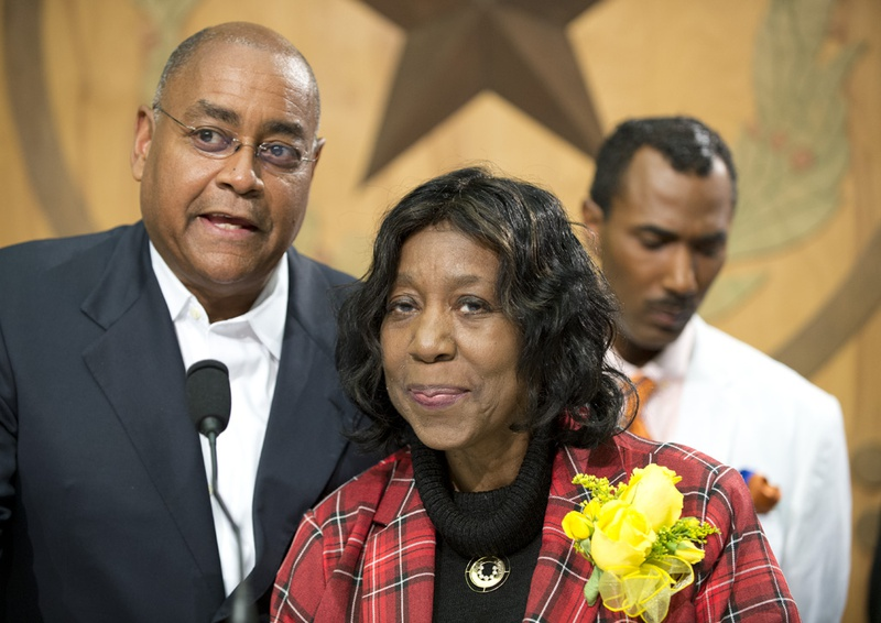 Sen. Rodney Ellis and State Rep. Ruth Jones McClendon, D-San Antonio, celebrate Gov. Abbott's signing of HB48 that establishes the Timothy Cole Exoneration Review Commission. In background is Cole's brother, Cory Session.