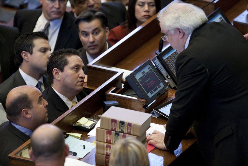 Trey Martinez Fischer, D-San Antonio, (left) calls a point of order on redistricting.