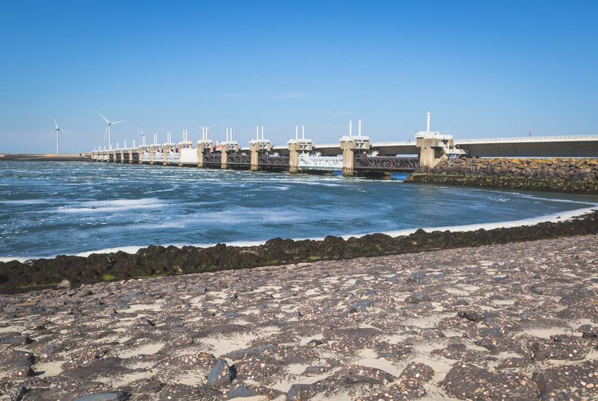 The 33-year-old Eastern Scheldt Barrier, made up of 65 giant pillars separated by vertical gates, is the largest of the De...