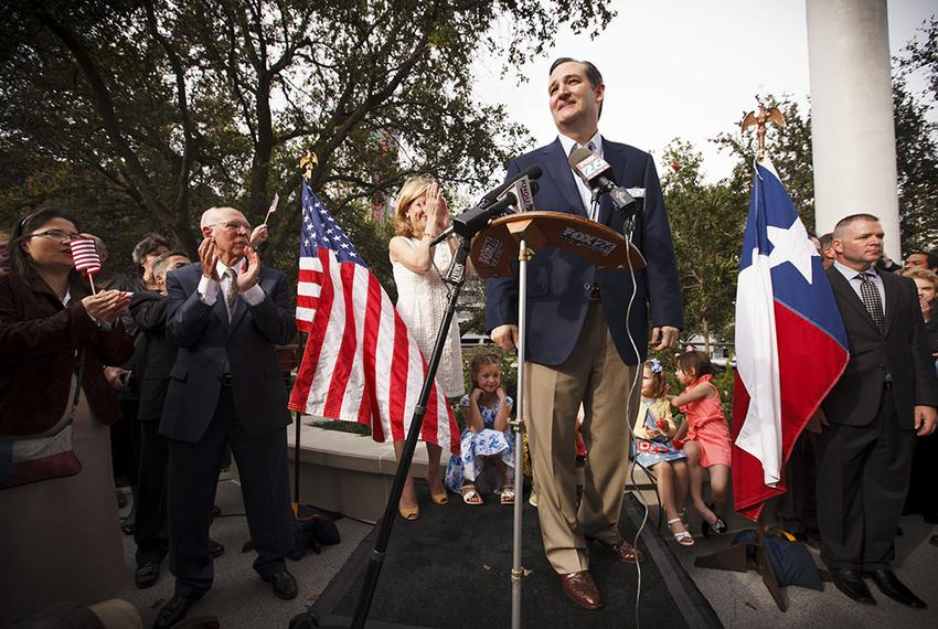 U.S. Sen. Ted Cruz speaks to supporters with his father Rafael, his wife Heidi and their children outside his new presidenti…