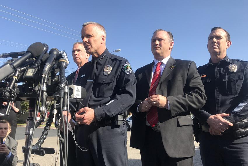 Flanked by federal agents, interim Austin Police Chief Brian Manley speaks at a press conference about the fourth bombing in…