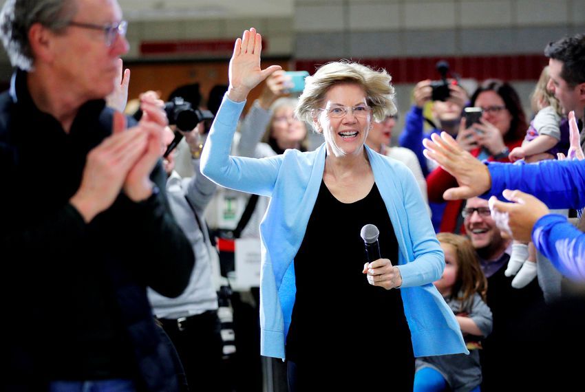 Presidential candidate and U.S. Senator Elizabeth Warren, Massachusetts, takes the stage at a campaign town hall meeting in Grimes, Iowa on Jan. 20, 2020.