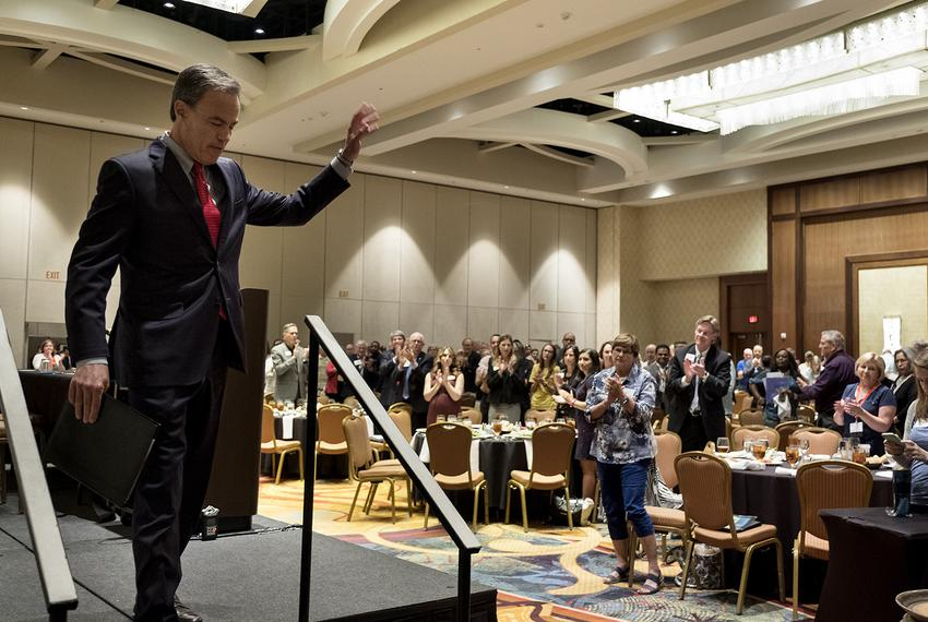 Texas House Speaker Joe Straus leaves the stage after speaking at the Texas Association of School Boards' annual summer le...