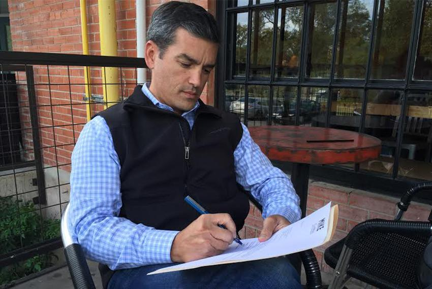 State Rep. Mike Villarreal, D-San Antonio signing letter resigning from state House to run for mayor of San Antonio.