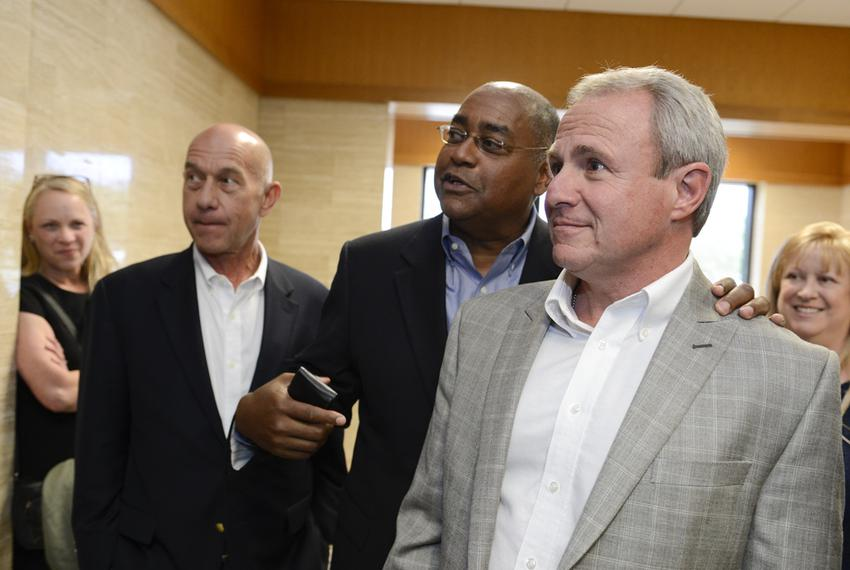 Senators John Whitmire, D-Houston, left, and Rodney Ellis, D-Houston, congratulate Michael Morton, right, at a court heari...