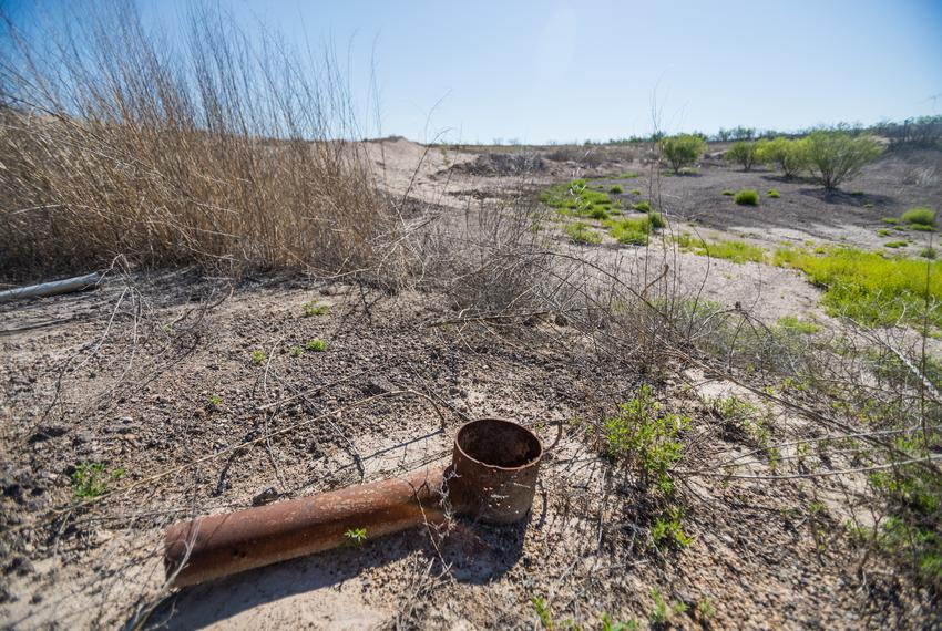 The land is sinking three-fourths of an inch every month around this abandoned well outside of Imperial in Pecos County, and…