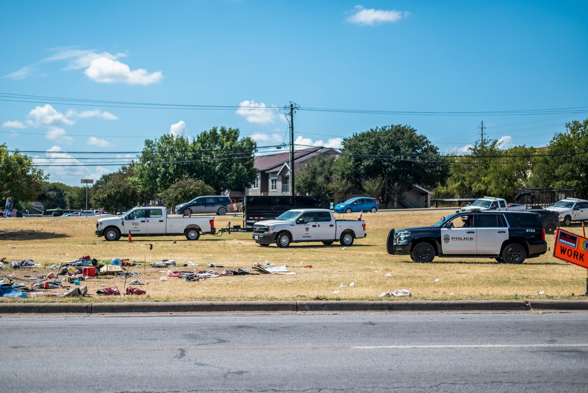City workers clear out a former homeless encampment on Riverside Drive on Sept. 28, 2021 in Austin. Many of the people who had been living in the camp said they weren't given enough notice and were not offered any place to stay. Sergio Flores for The Texas Tribune
