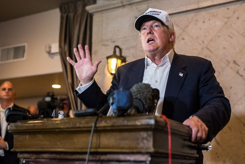 Donald Trump responds to questions during a 2015 trip to Laredo.