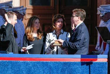 Dan Patrick is sworn in by his son Ryan, a state district judge in Harris County,while his daughter Shane and his wife, Jan, look on.
