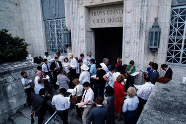 A real estate foreclosure auction on the steps of the Travis County Courthouse in Austin during the 1980's oil bust.