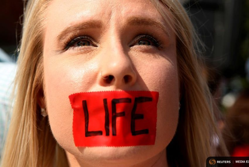 An anti-abortion protester demonstrated outside the U.S. Supreme Court on June 27, 2016, before the court struck down two key provisions of a Texas abortion law.
