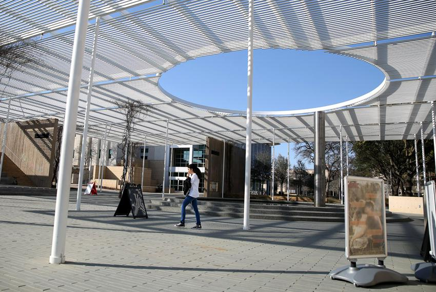 A student walks through a newly constructed pavilion on the campus of the University of Texas at Dallas. UT-Dallas has inv...