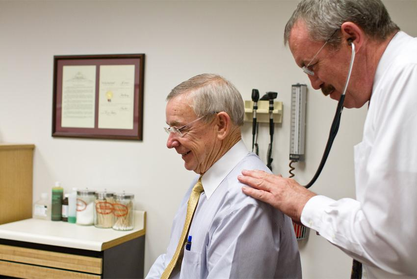 Capitol nurse practitioner Tim Flynn performs a routine check-up on state Rep. Warren Chisum on April 11, 2012.