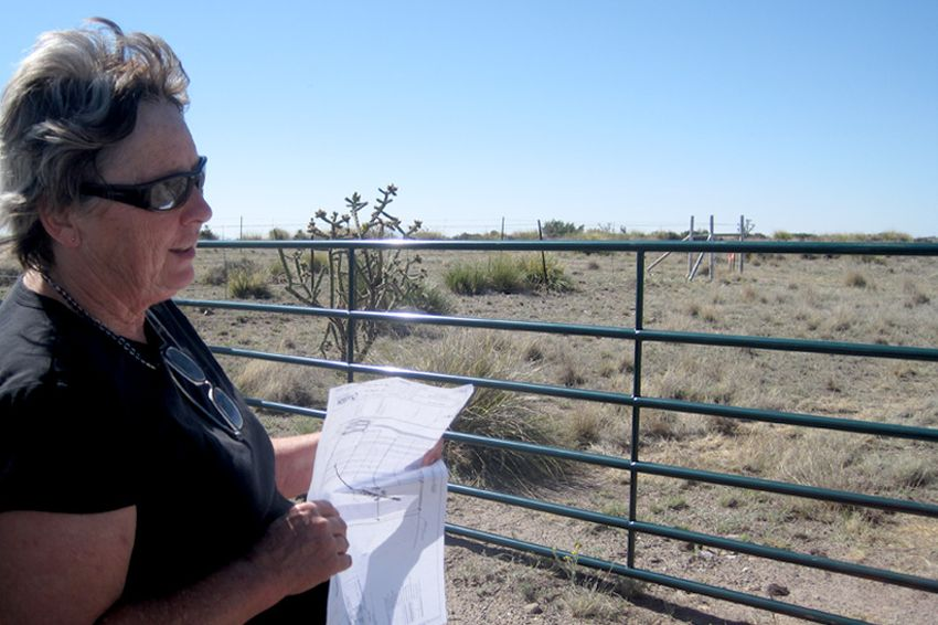 Malinda Beeman displays a map of the area where Tessera Solar plans to install 1,080 solar discs here to generate power for the city of San Antonio.