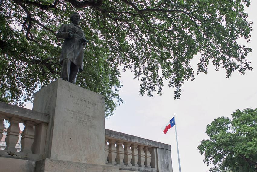 The statue of Jefferson Davis, once president of the Confederate States, stands just south of the Main Building on UT's ca...