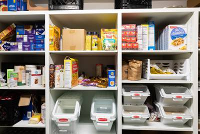 The hospitality coordinator and Perry Covington and his wife Karen keep the pantry stocked witha variety of foods thanks to the food bank and other local charities.