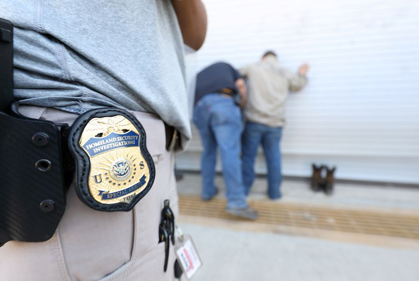 U.S. Immigration and Customs Enforcement officers arrested more than 100 employees on federal immigration violations at a trailer manufacturing business in the North Texas town of Sumner on Aug. 28, 2018.