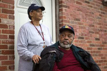"""Ricky Marie and Robert Robinson awaited the arrival of former President Bush's funeral train in Navasota. """"We're out here to honor and support the Bush family. It's also a big event for our town of Navasota,"""" said Ricky Marie Robinson."""