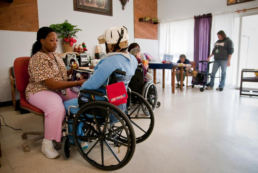 Austin State-Supported Living Center employee Tamika Mays is shown with resident Rebecca Hadnot in 2011.