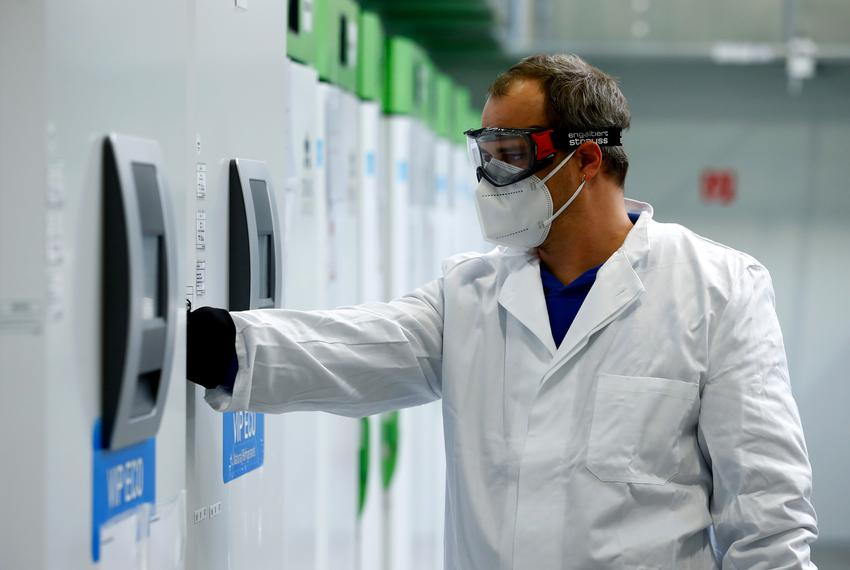An employee opens an ultra-cold refrigerator filled with COVID-19 vaccines at a secret storage facility in the Rhein-Main ar…