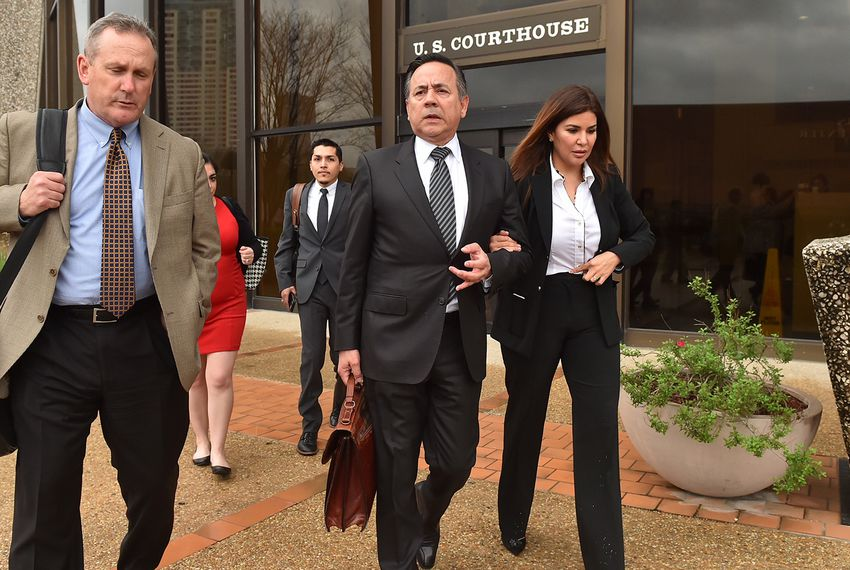 State Sen. Carlos Uresti, D-San Antonio (center) leaves the federal courthouse in San Antonio with his wife,Lleana Uresti andattorney Tab Turner, on Tuesday, Feb. 20, 2018.