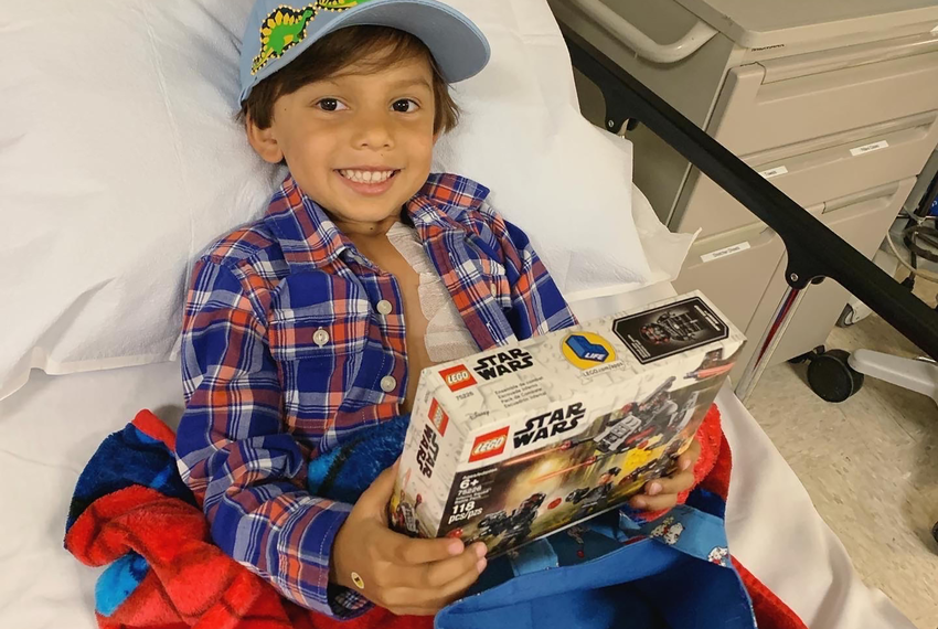 Nikhil Shah, 5, holds a Lego set at the clinic where he receives weekly chemotherapy treatments in San Antonio.
